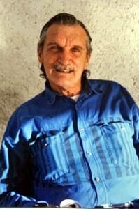 James E.  Holley
