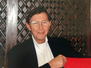 John G.  Belan