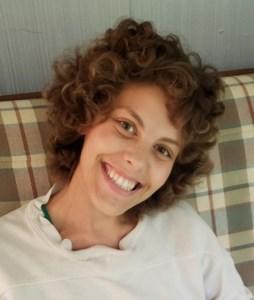 Megan E.  Santa Croce