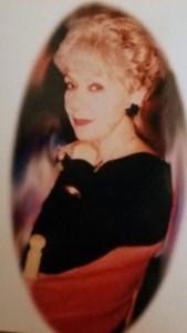 Olga  Mena