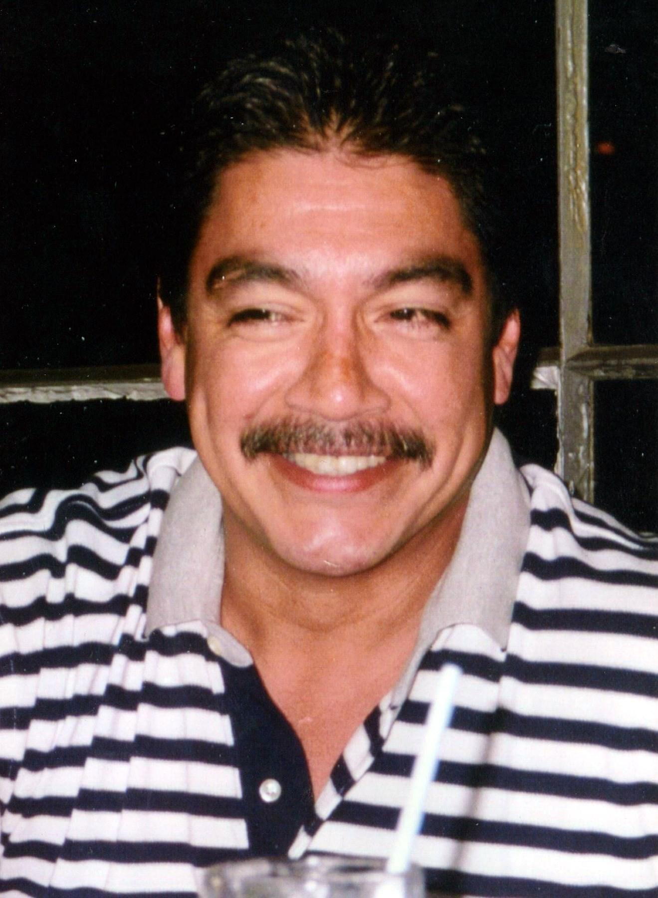 Marcus Dean  Flores