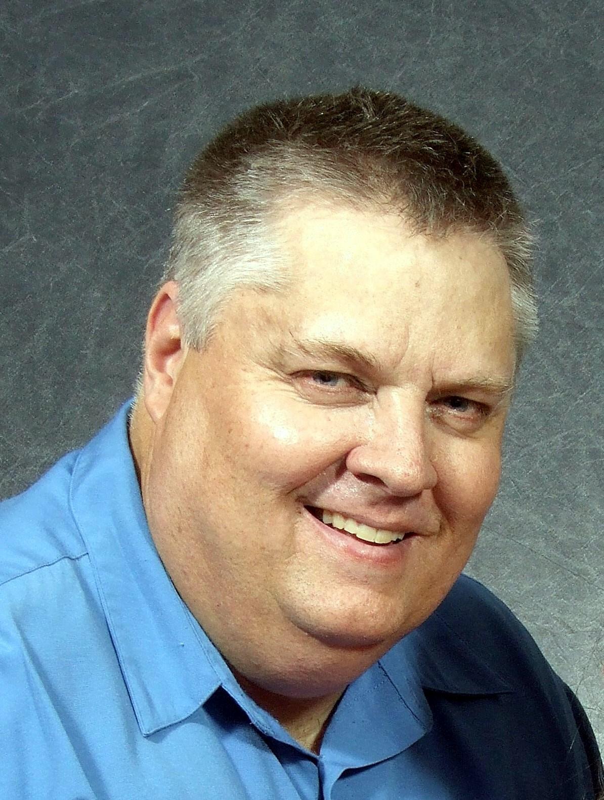 Lawrence E.  Squire