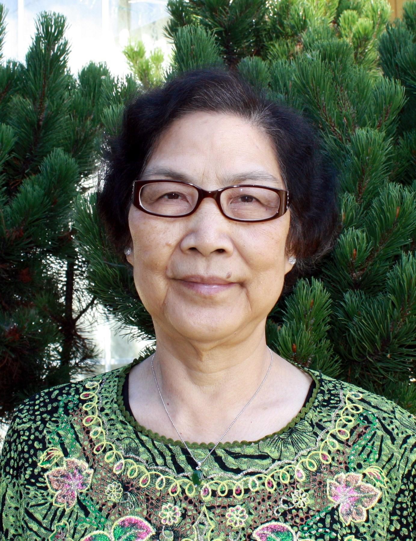 Qu Mei  Guan