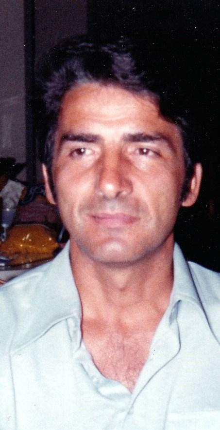 John C.   Porikos